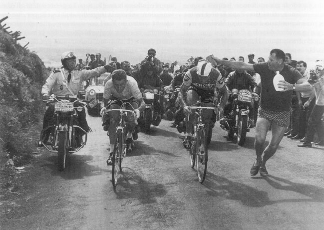 Tour de France 1964 - just before the picture below was taken and the French Gendarme (left) not happy with the spectator support for Raymond Pouildor