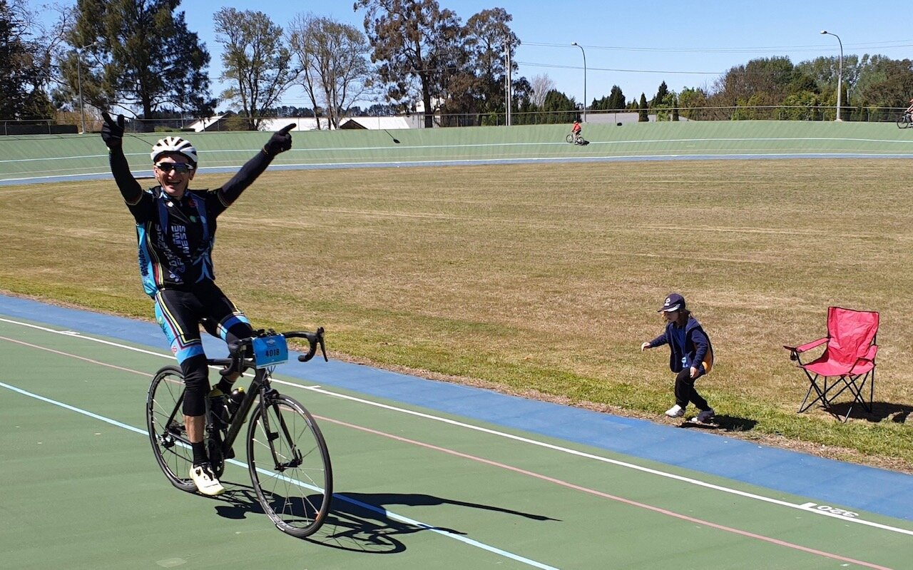 Bowral Classic @ 20 Oct @ Bowral Velodrome … Eric Dole (BiciSport) doing the whole Paris Roubaix style victory salute on the Bowral Velodrome with the local crowd expressing their support