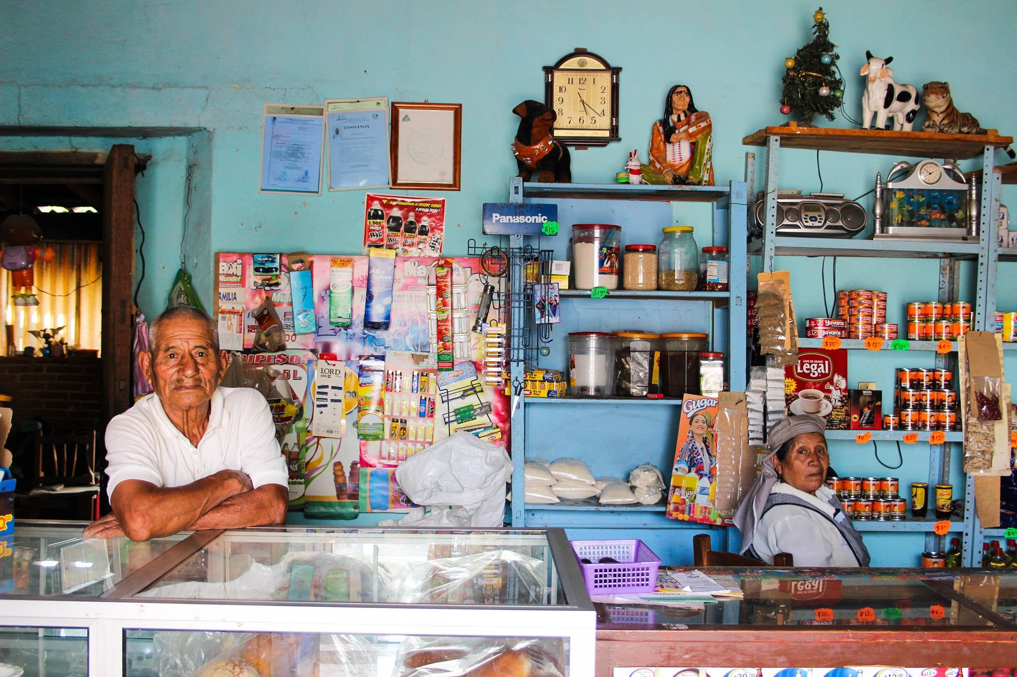 A couple attend their shop in the outskirts of Oaxaca City, Mexico. In their 80s, they grew up, met and married in the same small town.