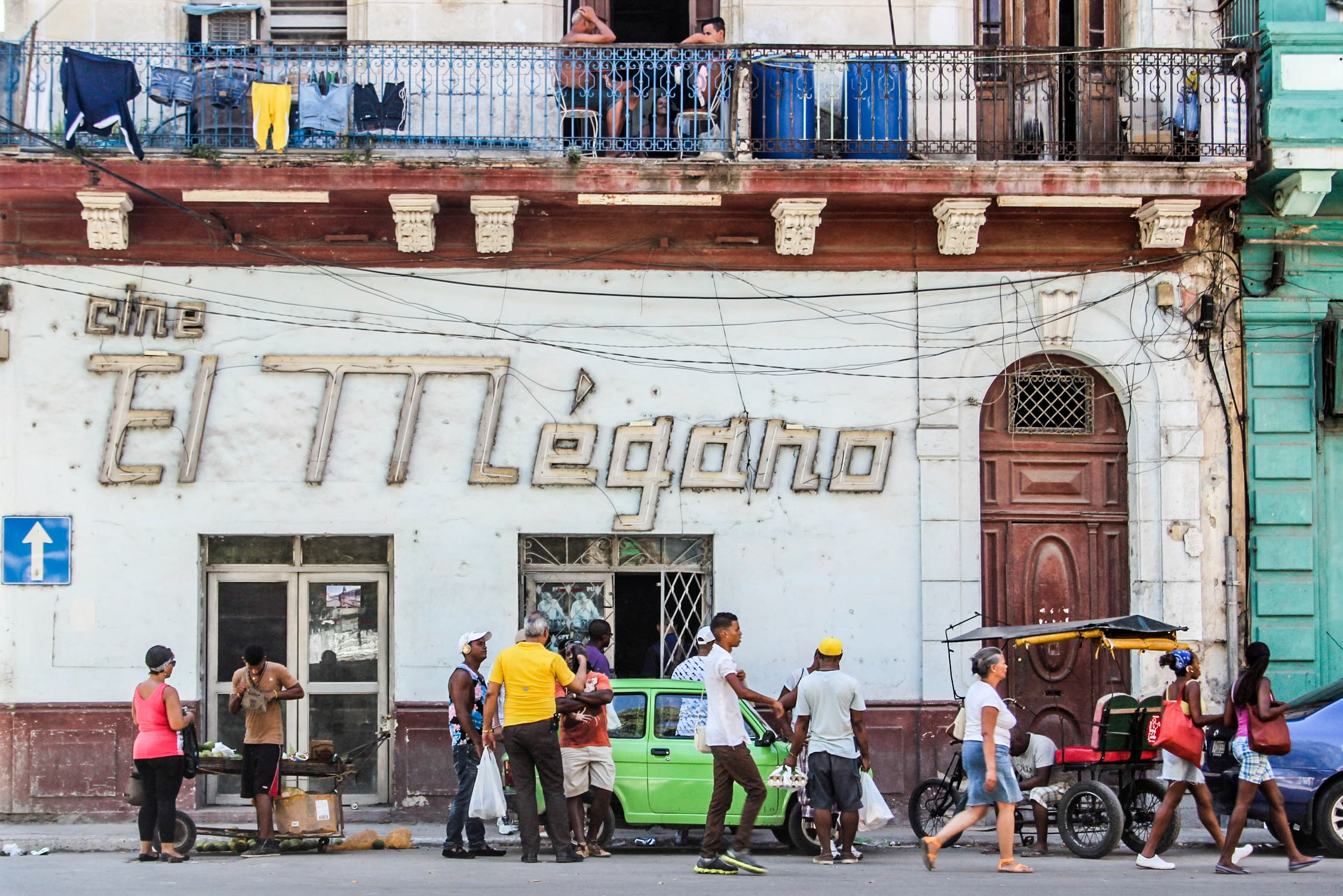 """Outside a cinema in Havana, Cuba.   In October 2013, the Cuban government banned privately run cinemas. The state closed many 2D and 3D salons in homes and restaurants. Although the communist nation has relaxed restrictions against the private sector in the past decade, the government announced in the state run newspaper Granma it needed to bring """"order"""" to the management of independent businesse  s. According to the BBC, government run cinemas shy away from showing Hollywood and other mainstream films. More recently, the NY Times reported that Miguel Coyula, a Cuban filmmaker, had his crow-funding campaign suspended on Indiegogo. After he raised US$5200, the website determined that transferring funds to Cuba or a Cuban resident would violate the United States' economic embargo. The lift of the U.S. sanctions against Cuba will change the face of independent Cuban cinema. Film-makers will be able to receive financial investment directly from the U.S. and travel freely between the two nations."""