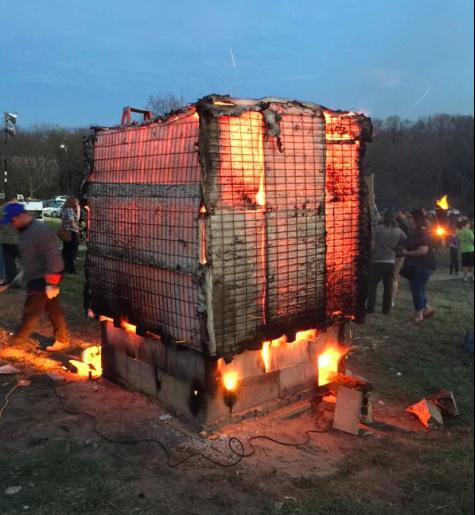 A performance kiln burns near dusk.