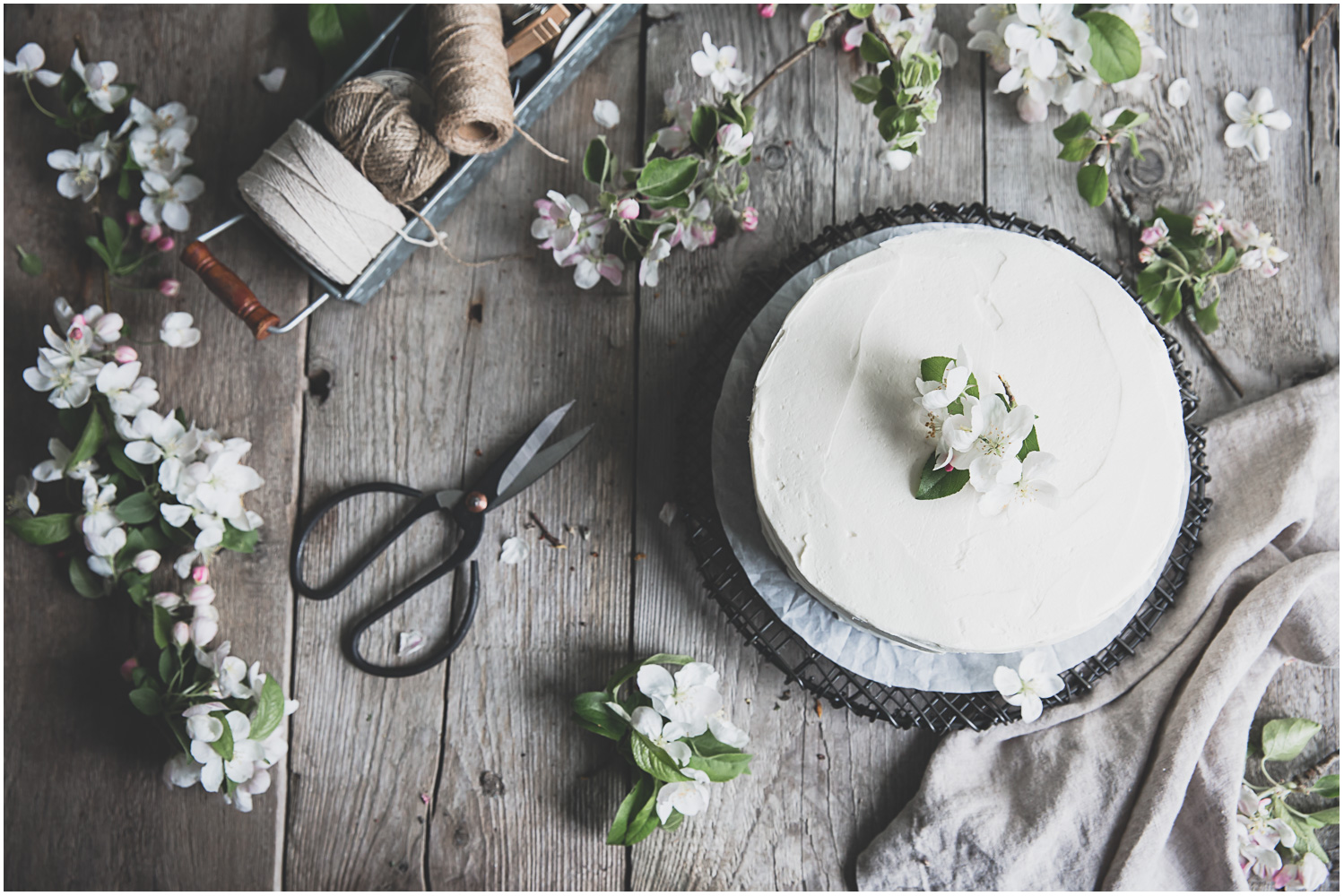 Classic white cake decorated with apple blossoms