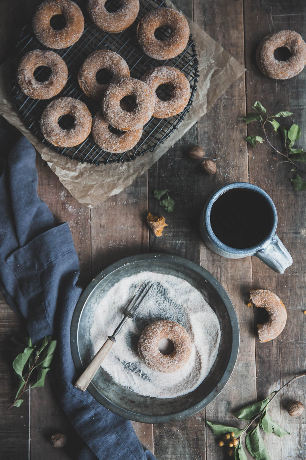 Freshly baked pumpkin donuts with hot coffee