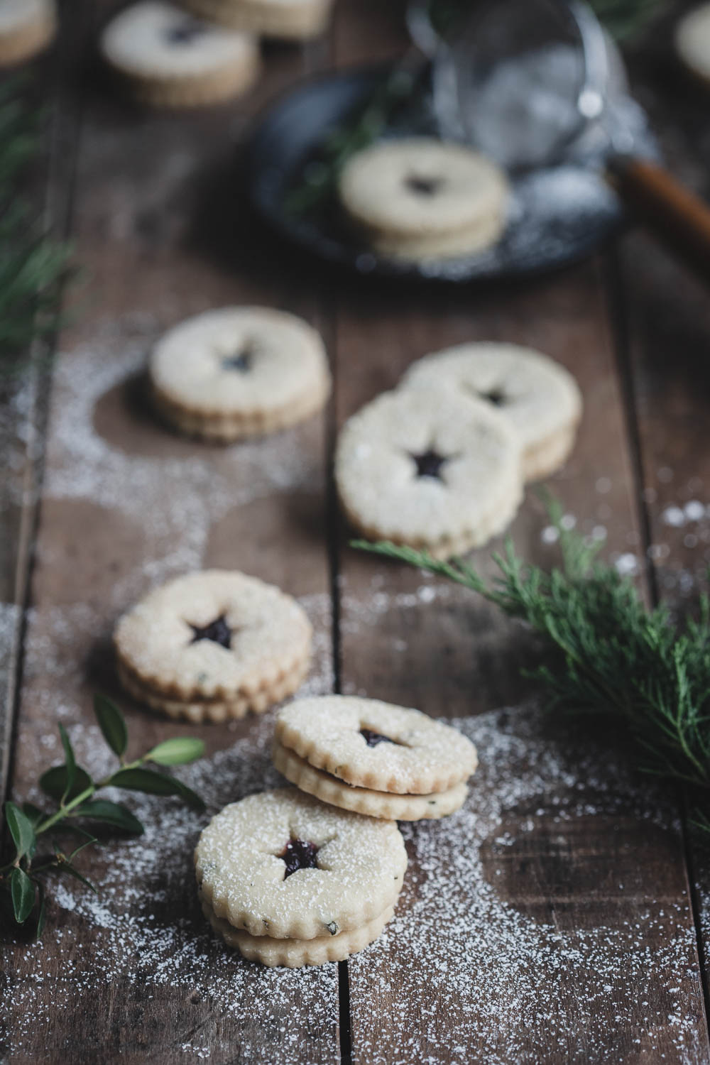 Rosemary shortbread Linzer cookies with blueberry preserves, lightly dusted with powdered sugar
