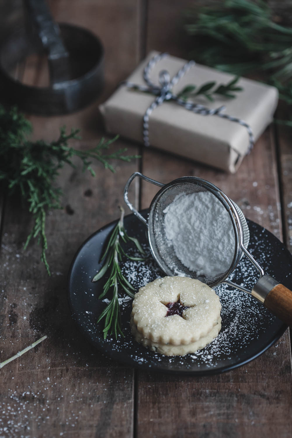 A light dusting of powdered sugar tops these rosemary shortbread Linzer tarts