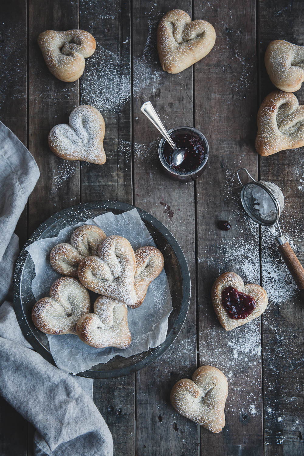 Sugar-dusted cardamom buns with raspberry jam
