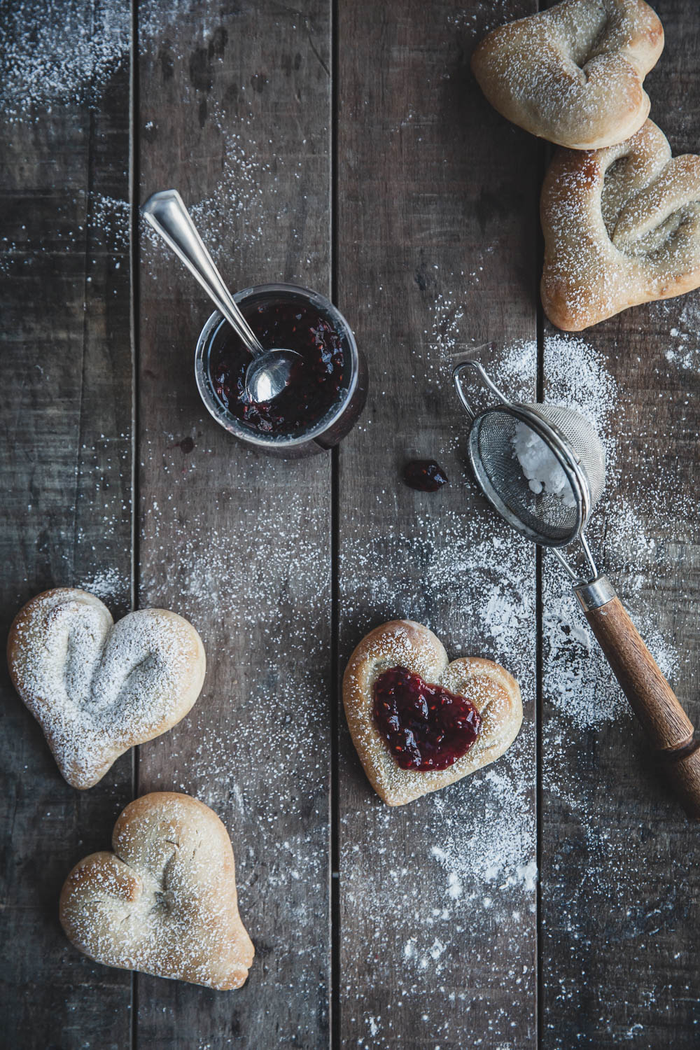 Heart-shaped cardamom buns with raspberry preserves
