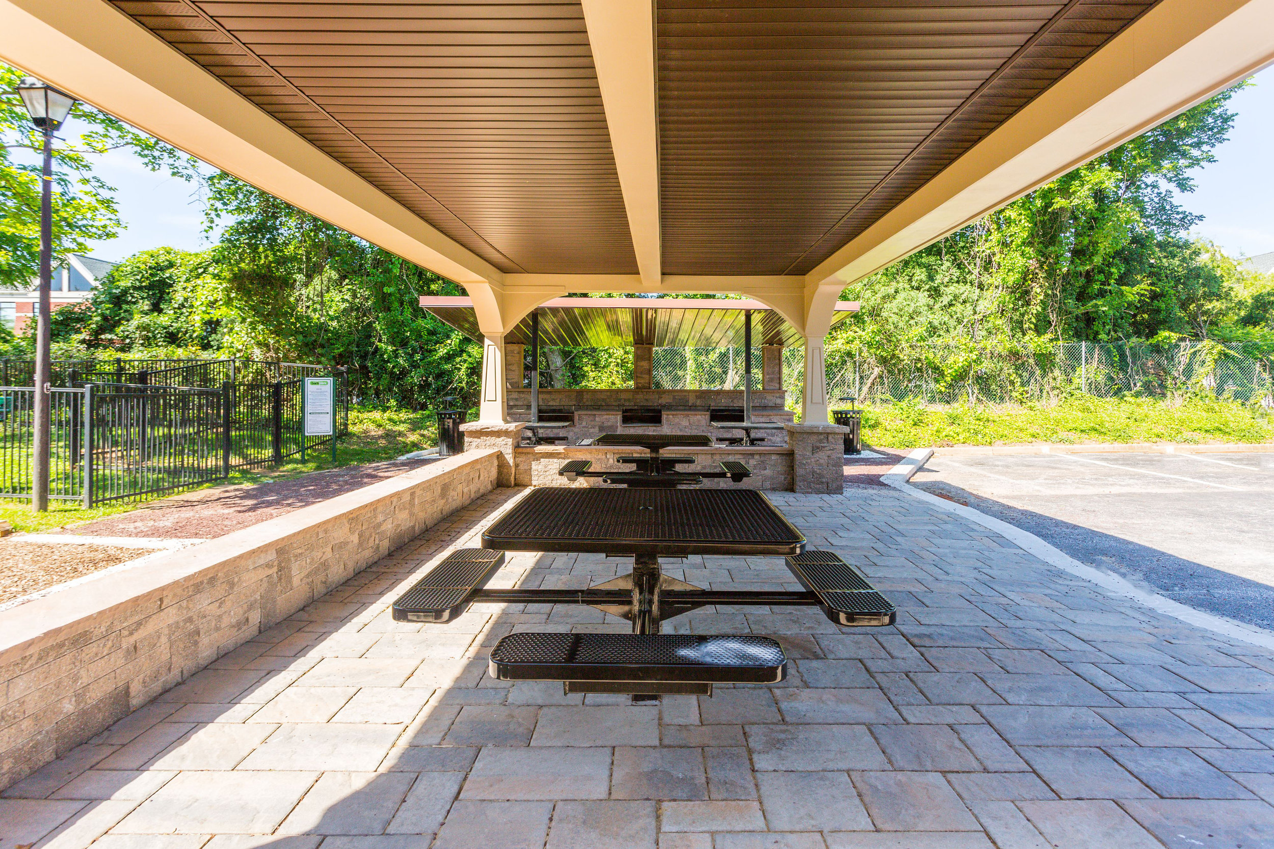 Outdoor Grilling & Dining Area at Annen Woods Apartments in Pikesville, MD