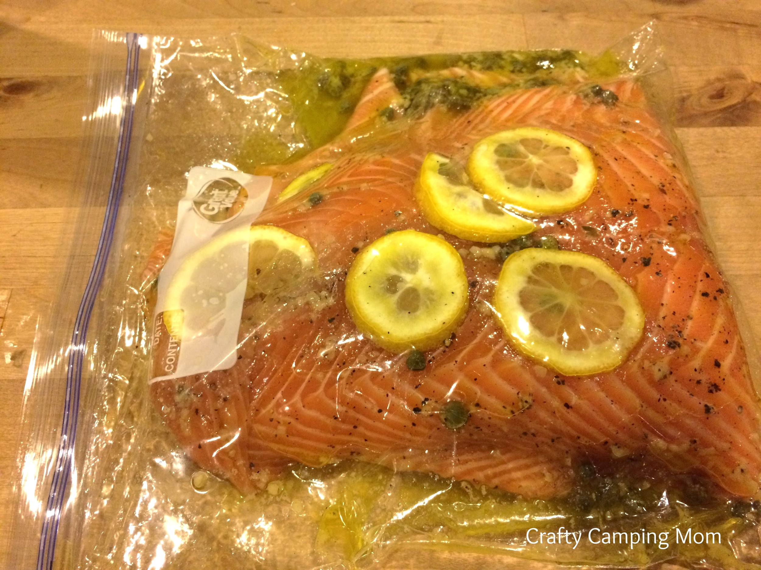 "Salmon marinating in the easy clean-up or ""take camping"" baggie."
