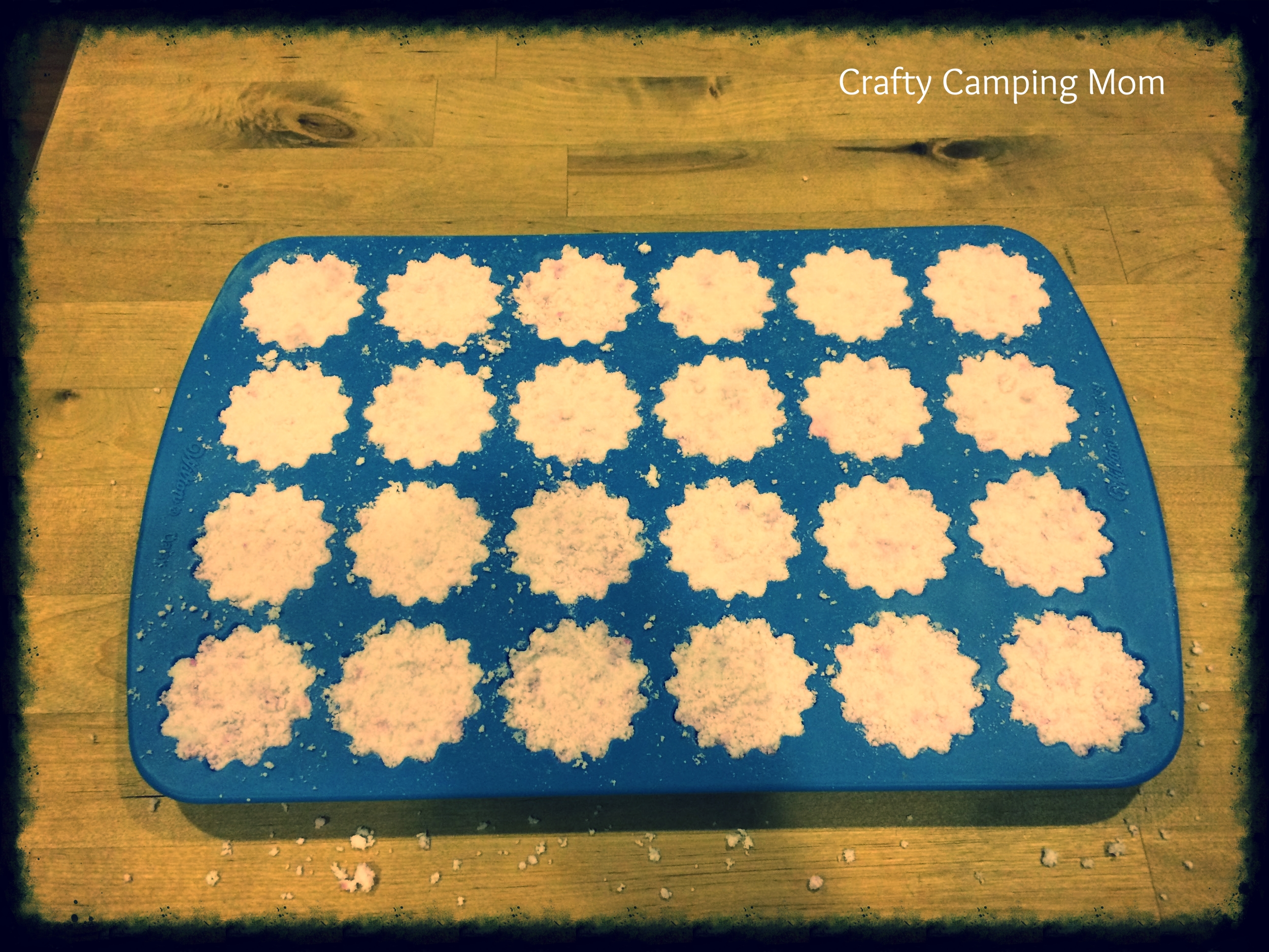 Molds are filled and pressed with mixture.