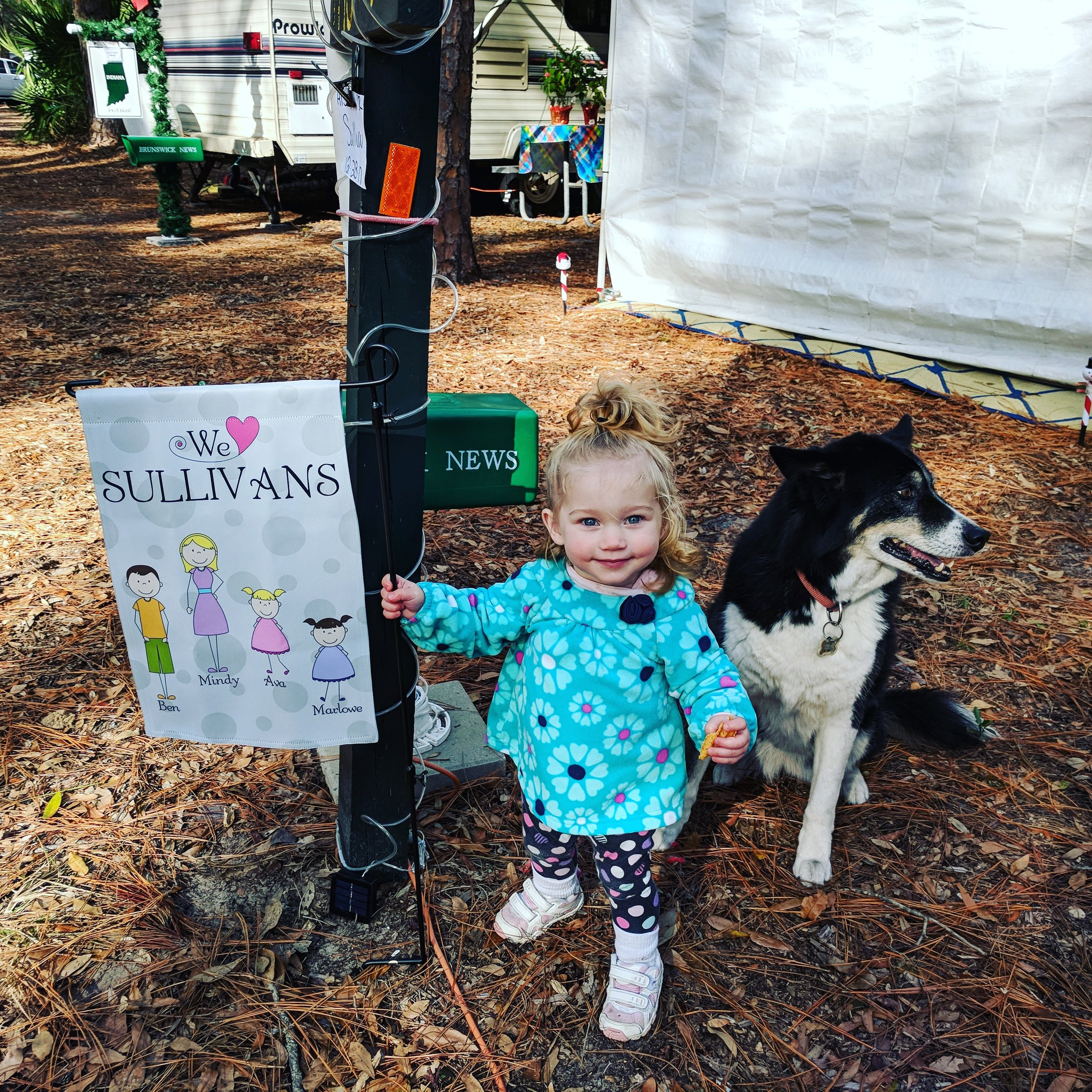 Marlowe standing proud with Lula Belle next to our flag