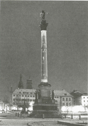 "Krzysztof Wodiczko, Public Projection on the ""Victory Column"", Schlossplatz, Stuttgart, West Germany. (Colour slide projected on trunk of column)"