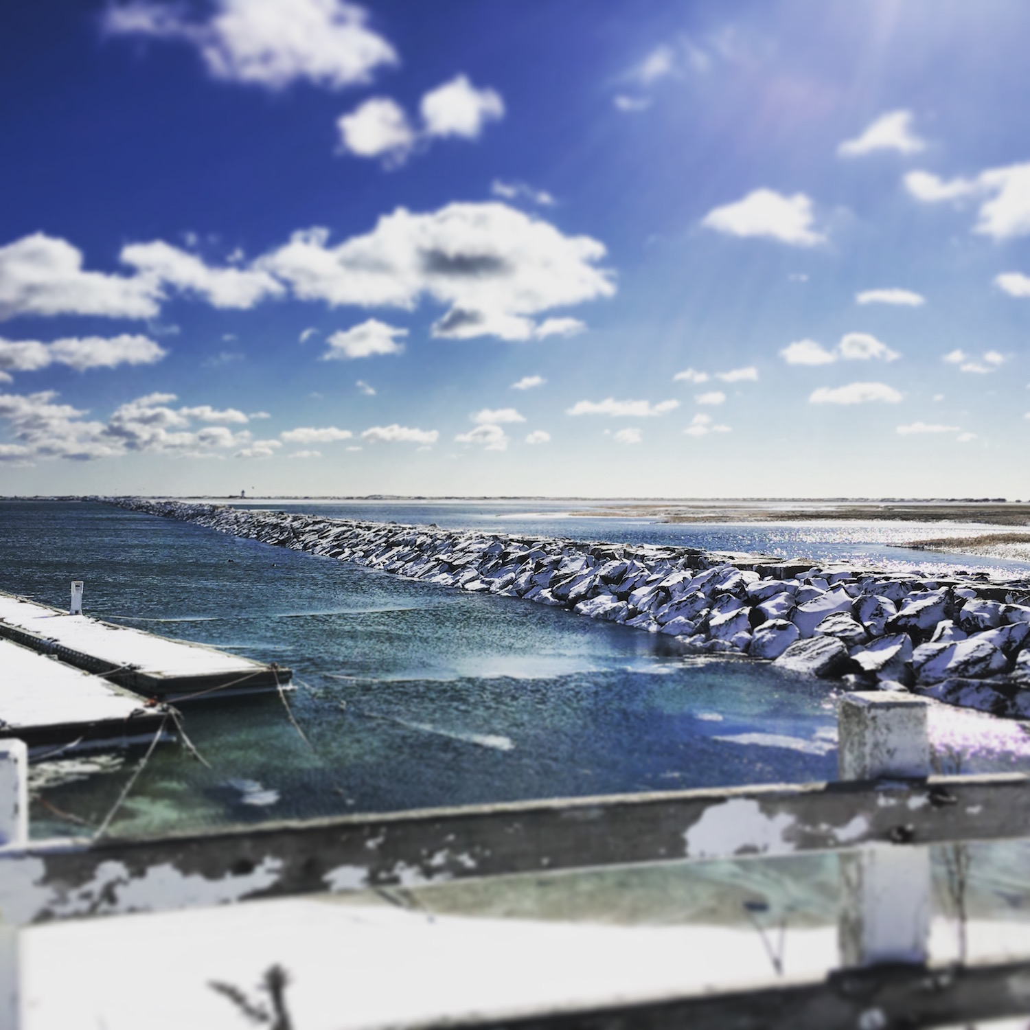 The Provincetown Inn at what feels like the end of the Earth, looking across the harbor at a snowy breakwater.