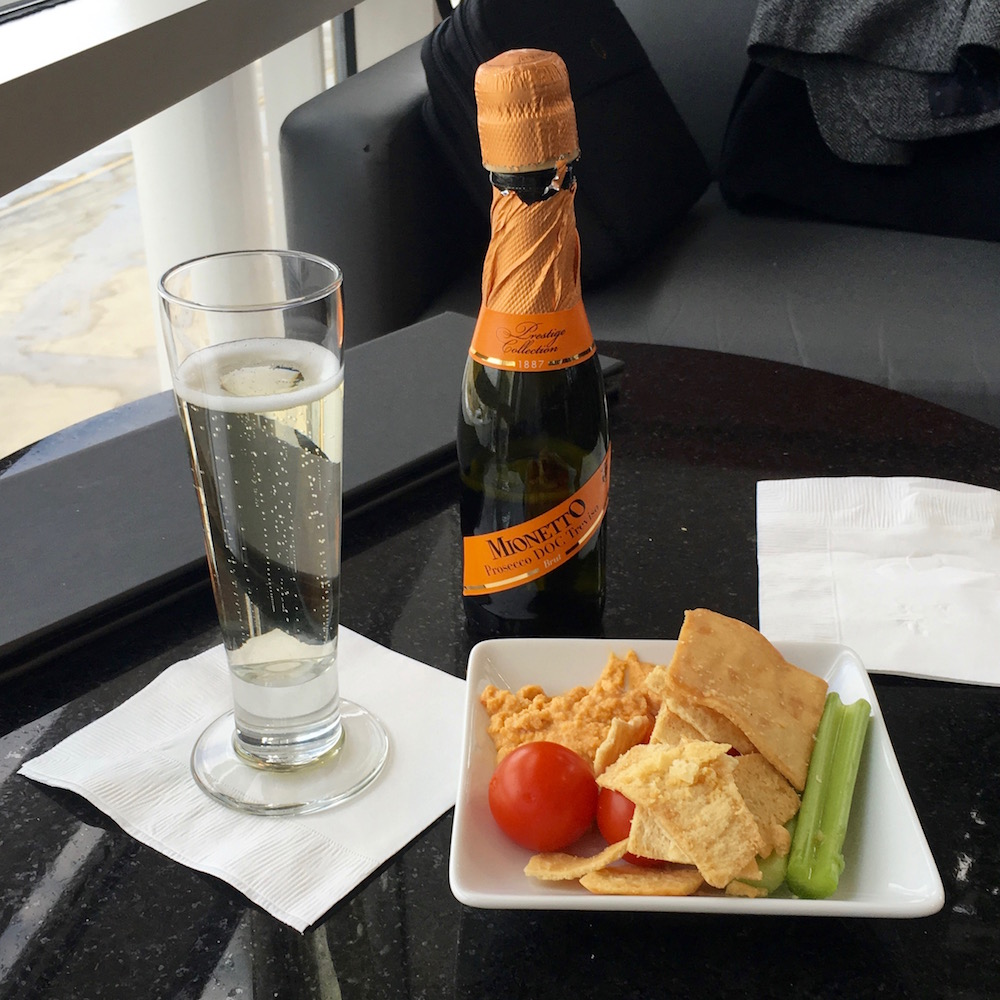 Chips, veggies, hummus, and a glass of sparkling wine make the perfect anecdote to an otherwise hectic day on the road.