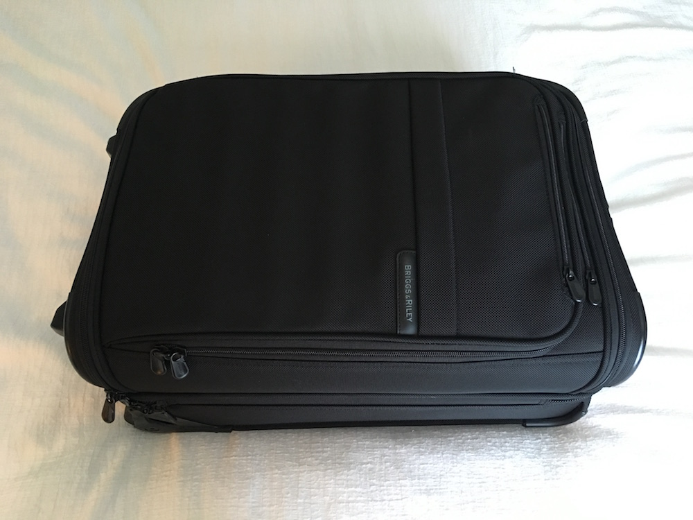 Fold and zip into the size of a typical carry on. I am on a small Embraer 175 airplane, and it fit very reasonably into the overhead bin.