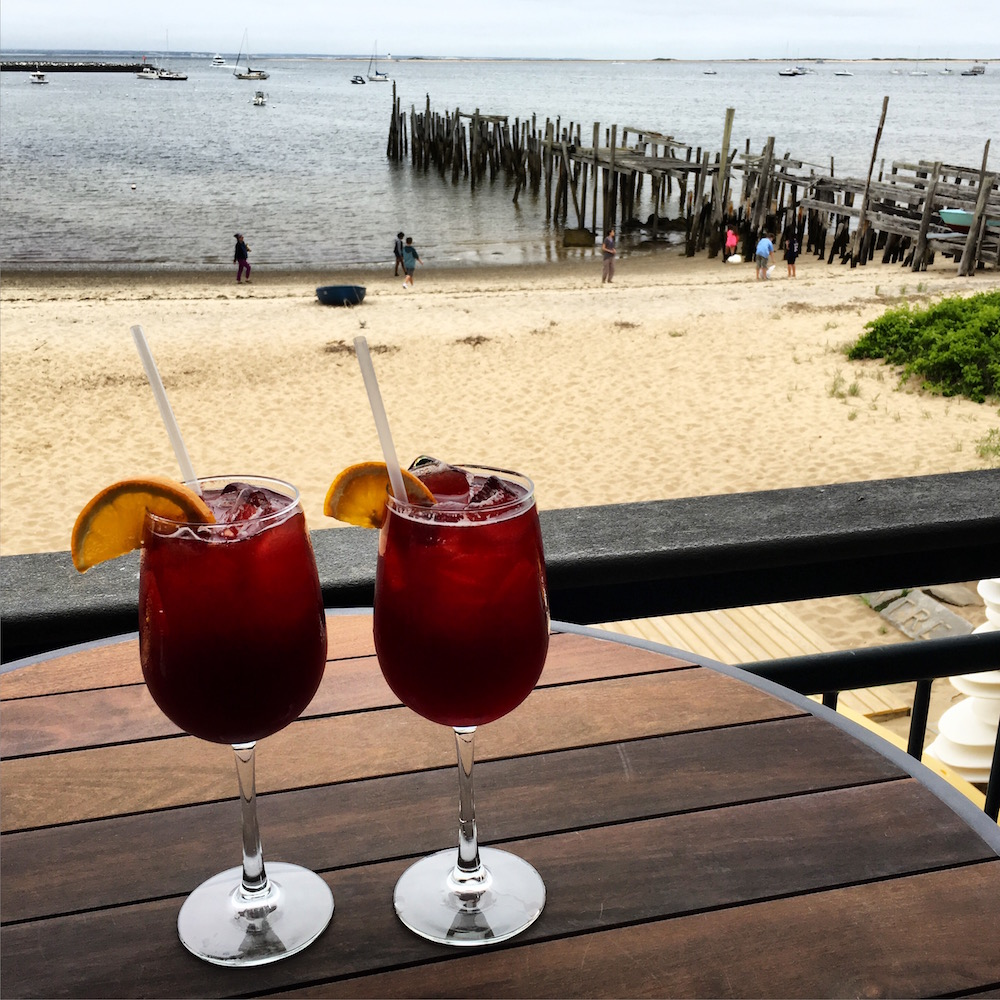 """Could have done for a more blue sky, but nonetheless were I to show you one picture that sums up """"the good life in summertime"""", I'd be hard pressed to find something more compelling than the site of a sangria on your table and the harbor view from the Ross' Grill balcony beyond."""
