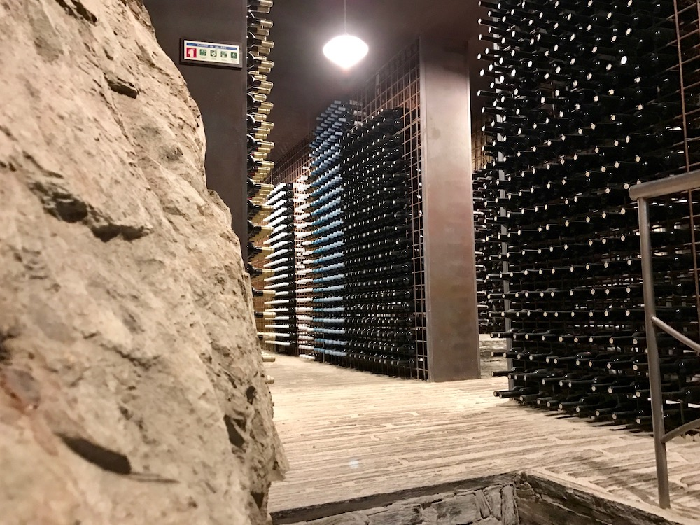 The winery keeps 100 bottles of each wine each year for inclusion in their library, cut into the mountainside like the rest of the winery.