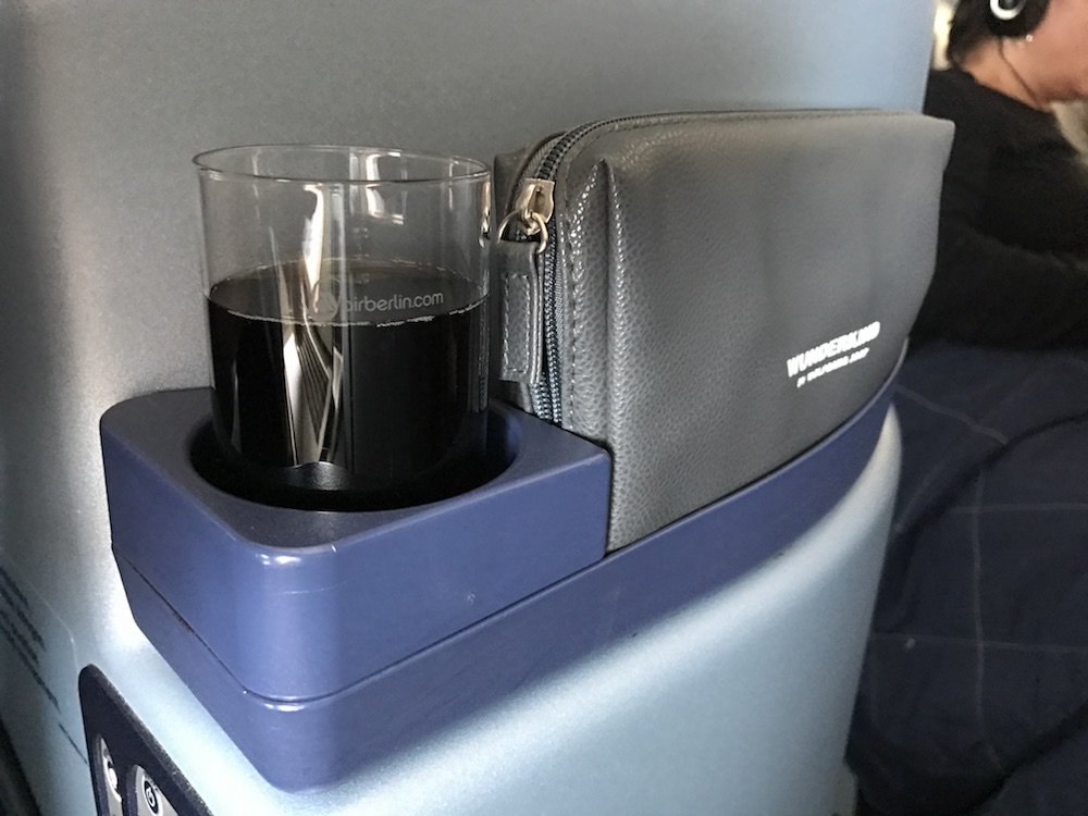 Do yourself a favor with the wine, and locate it in the cupholder next to you when you're doing something other than eating (i.e. passively sipping).