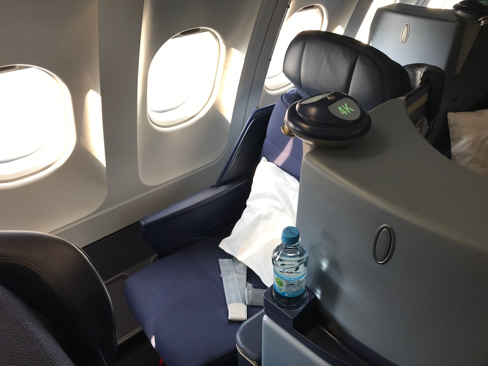 "Meanwhile, the ""true"" window seats are great. They each sweep in about three windows worth of space, and are protected on the aisle side by the foot cubby of the seat behind you."