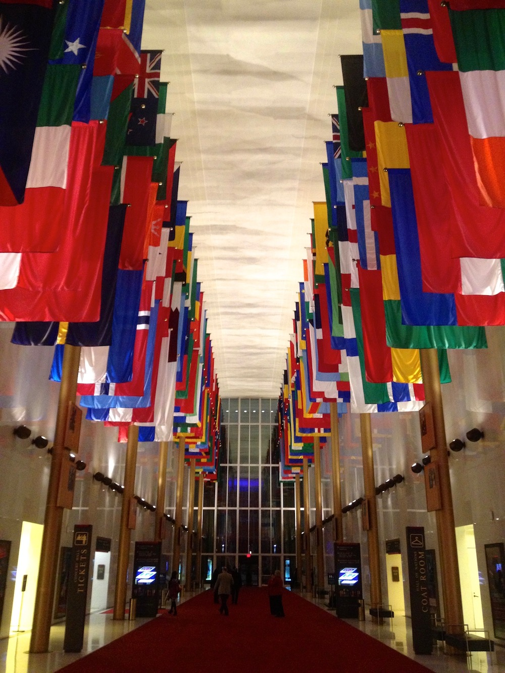 E Pluribus Unum . Out of many, one. The flags of the many places we've come from -- the world's vibrant nations -- hang majestically at the Kennedy Center in Washington, DC.