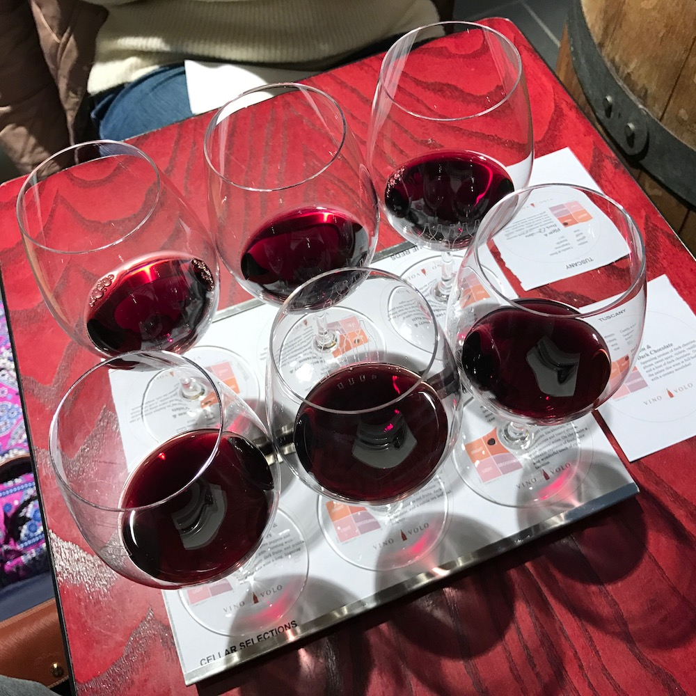 Do yourself a favor in Boston's Terminal E... have a meal at Vino Volo wine bar, and try a flight of wine before you fly.