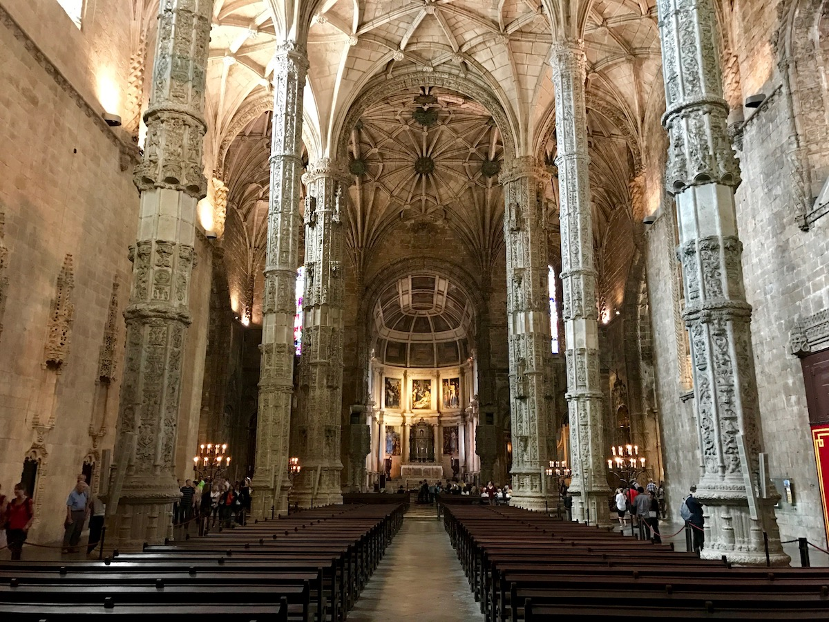 Inside the Mosteiro dos Jerónimos. Note how the architectural style evolves from Gothic to Renaissance towards the choir near the altar.