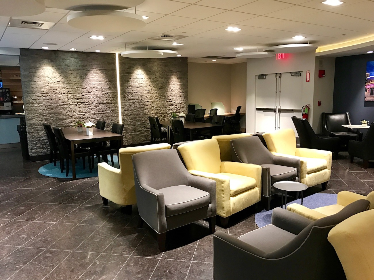 """Quiet and comfortable in """"The Club"""" in Boston's Terminal E."""