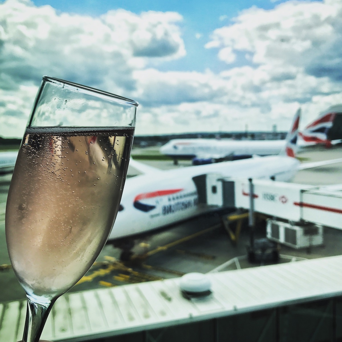 Big windows, beautiful planes, and a glass of wine make for a good way to pass the time.