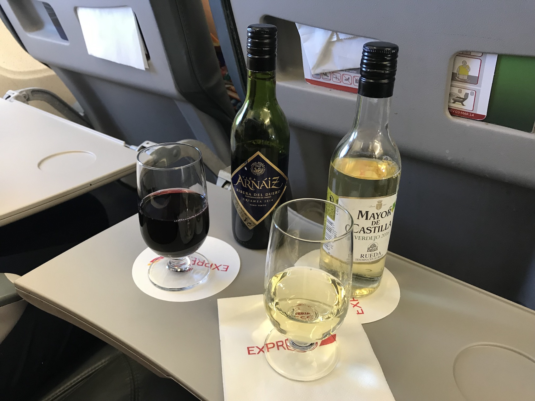 It's still airplane wine, but it's better than usual... and we have the middle tray table upon which to keep it.