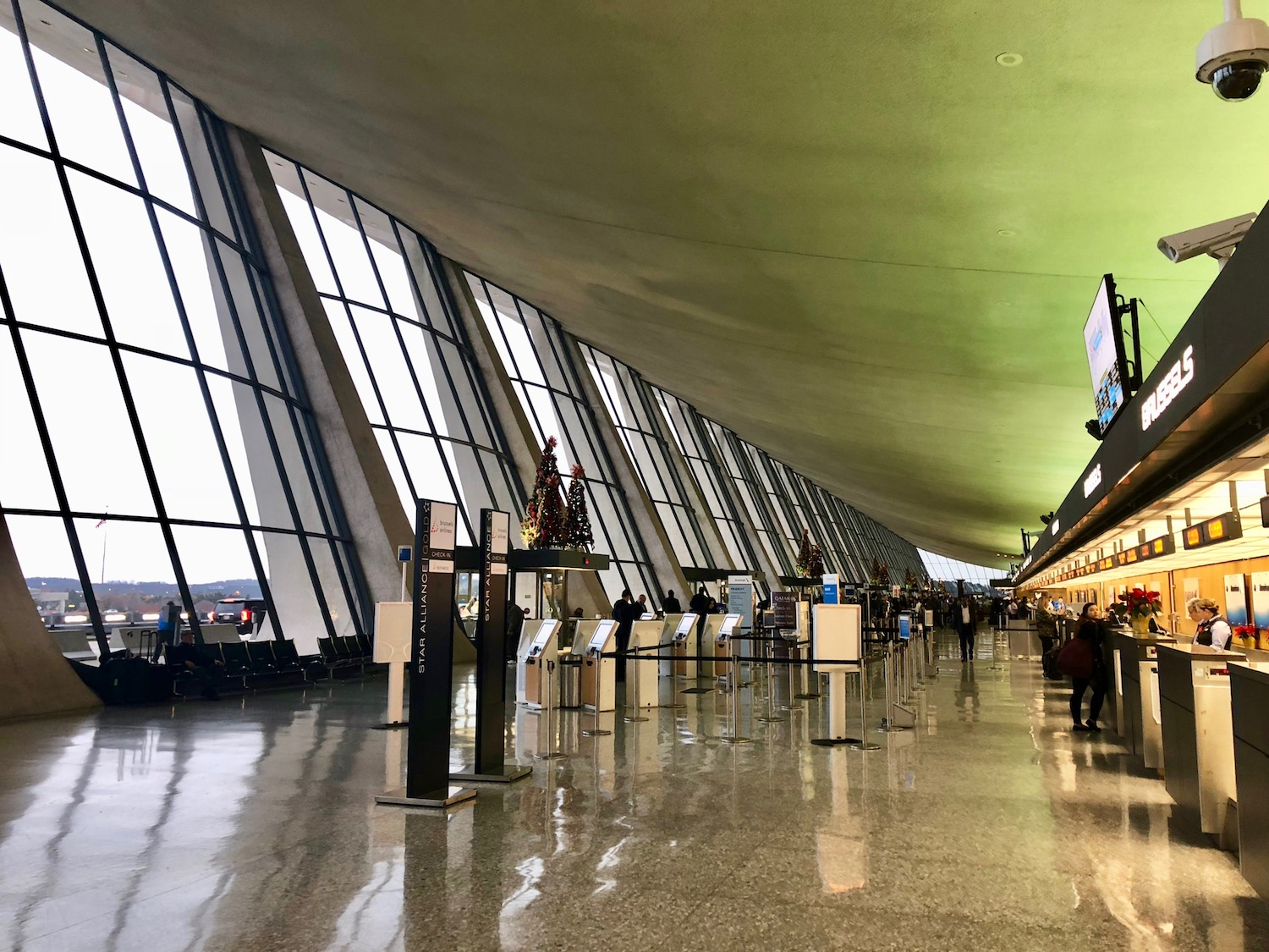Dulles still boats one of the most undeniably cool main terminal designs. Dated, but still stunning.