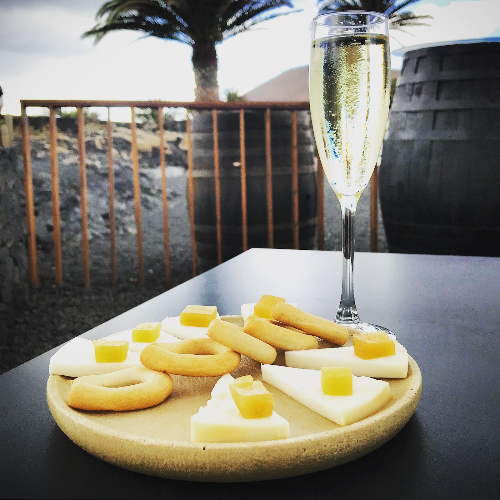 Malvasía Volcánica sparkling alongside traditional Canarian cheese and fruit.
