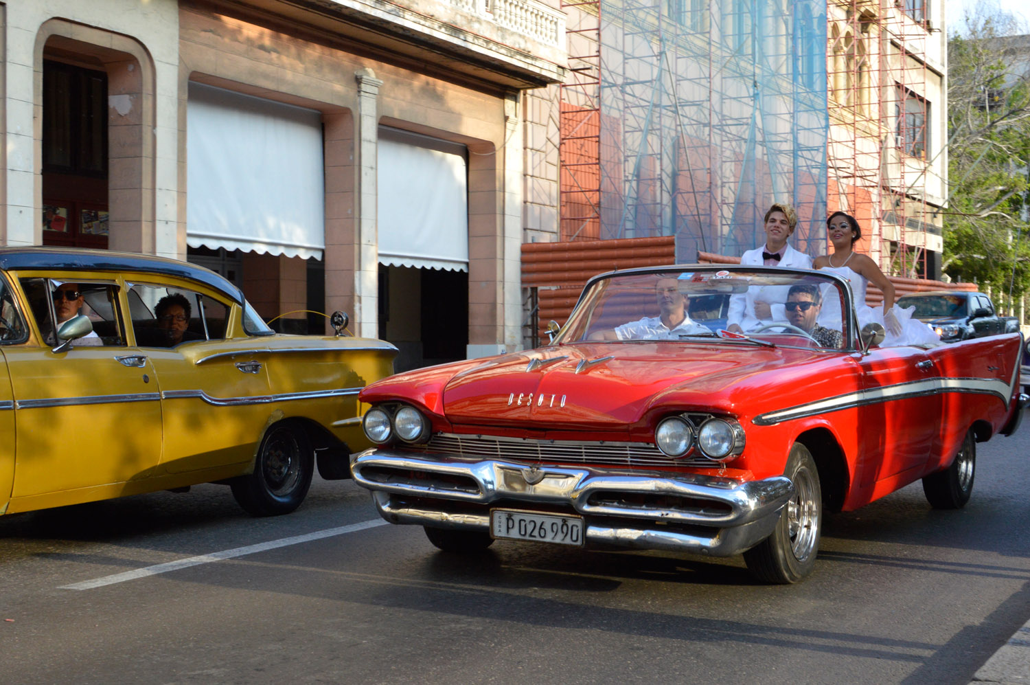 Cuba-Havana-Red-Classic-Car-Couple-Celebration.jpg