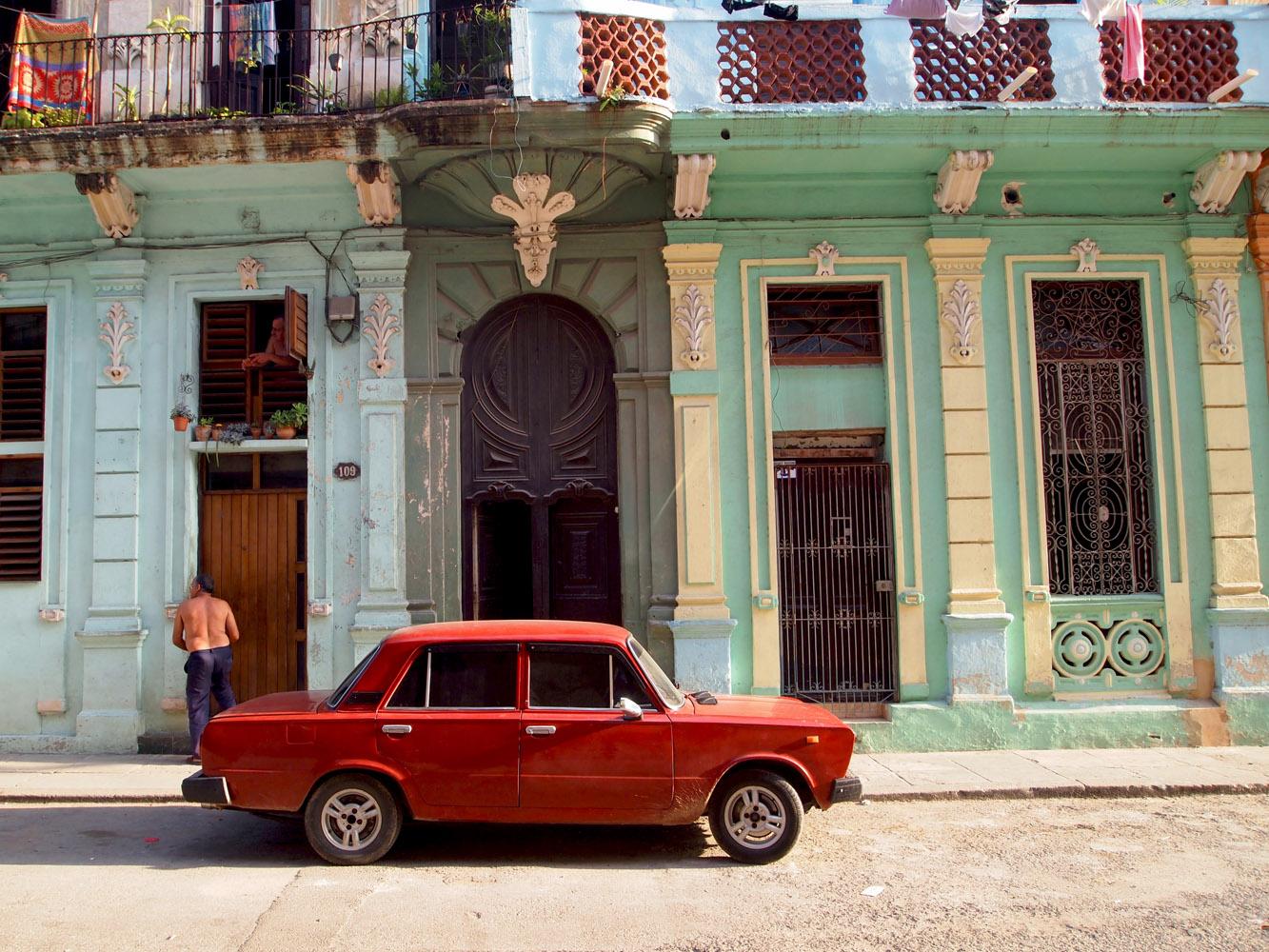 Cuba-Havana-Old-Man-Red-Russian-car