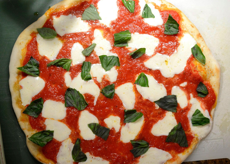Pizza-Margherita-making-home-Mozzarella-basil-leaves.jpg