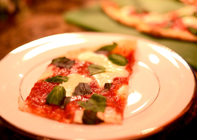 Pizza-Margherita-making-home-slice-on-plate.jpg