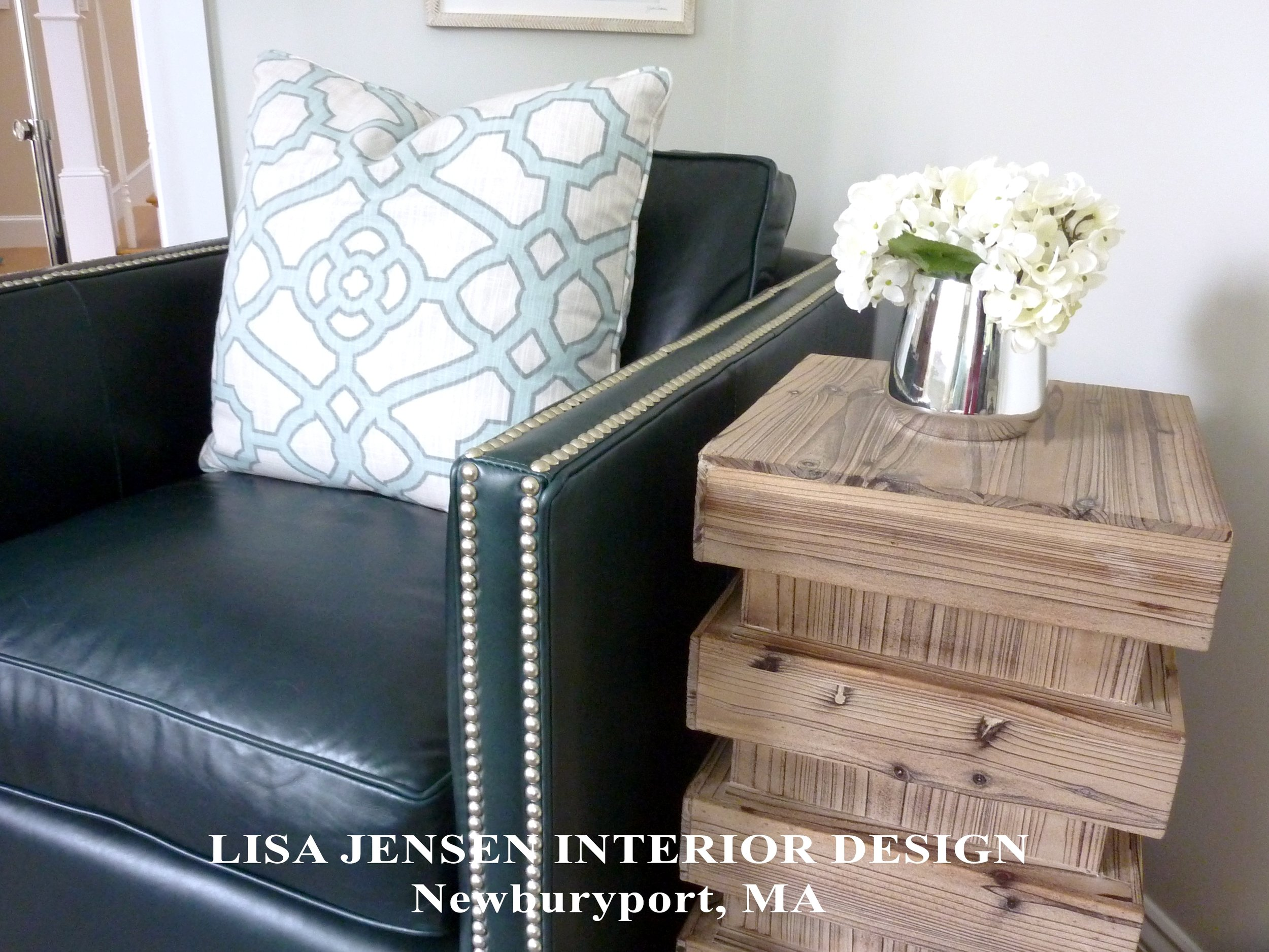 A closeup of furnishings selected by Lisa Jensen Interior Design showcasing a balance between textures, materials, colors, shapes, masculinity and femininity.