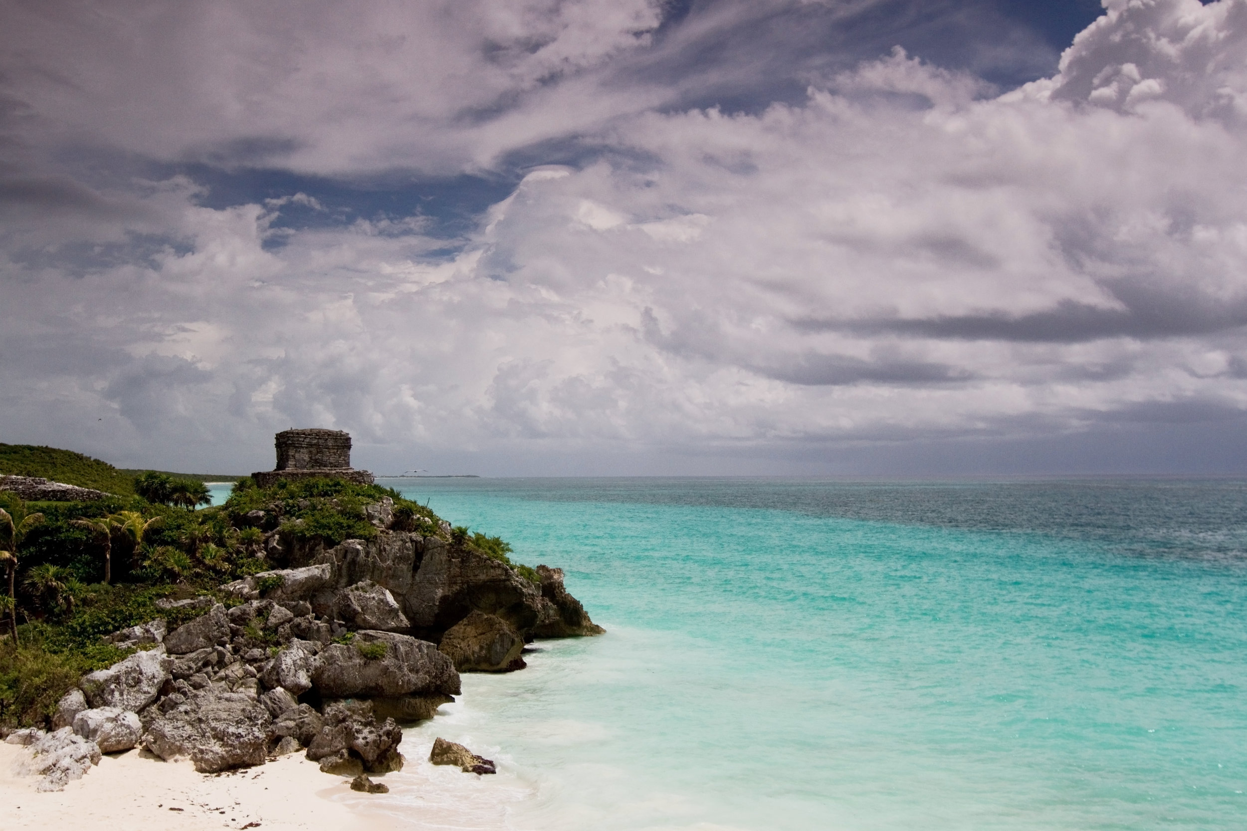 The ruins at Tulum are just one of the many attractions near Cancun, Mexico, whose low season happens to correspond with the peak season for weddings in the U.S. (May, June, and July), making it an excellent choice as a honeymoon destination.