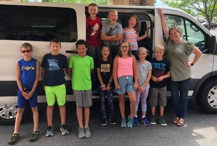 A group of excited campers head off to Joy Ranch