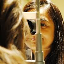 Dr. Kaw doing eye exam