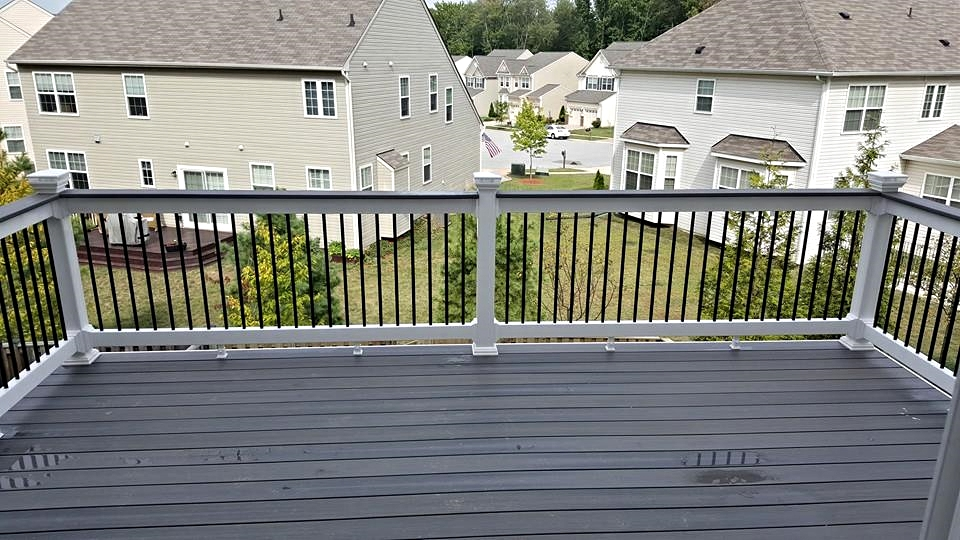 Gray Birch Deck with White Railings and Black Balusters