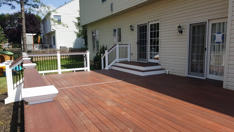 Cinnabar Fiberon Symmetry Decking with a landing/platform step out from house.