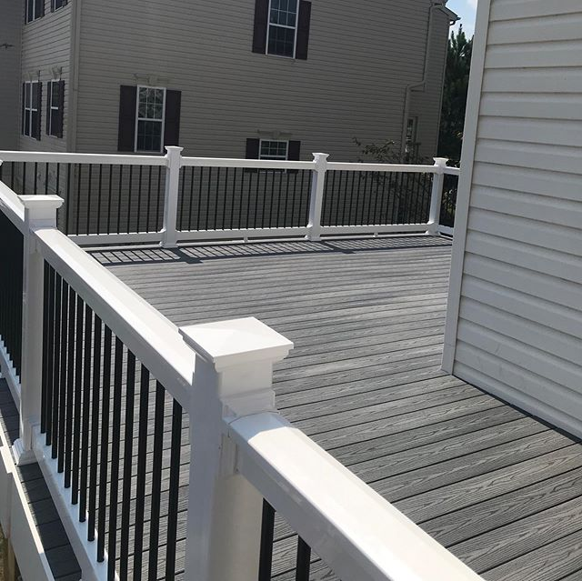 An L shaped deck we just finished up. Fiberon, good life decking in Beach house. With upgraded black aluminum balusters.