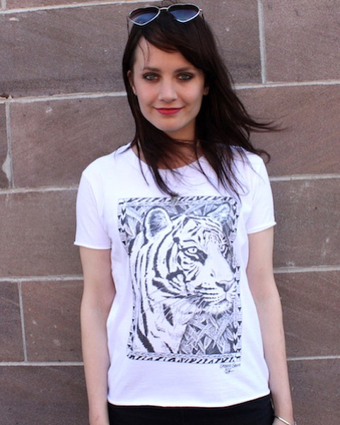 It's #globaltigerday! Make a difference by what you wear. Every purchase of our hand drawn tiger shirt gives back $5 to help @natgeo #savebigcats. Shop link in bio. #tigers #causeanuproar 🐯Design by @marnie_art