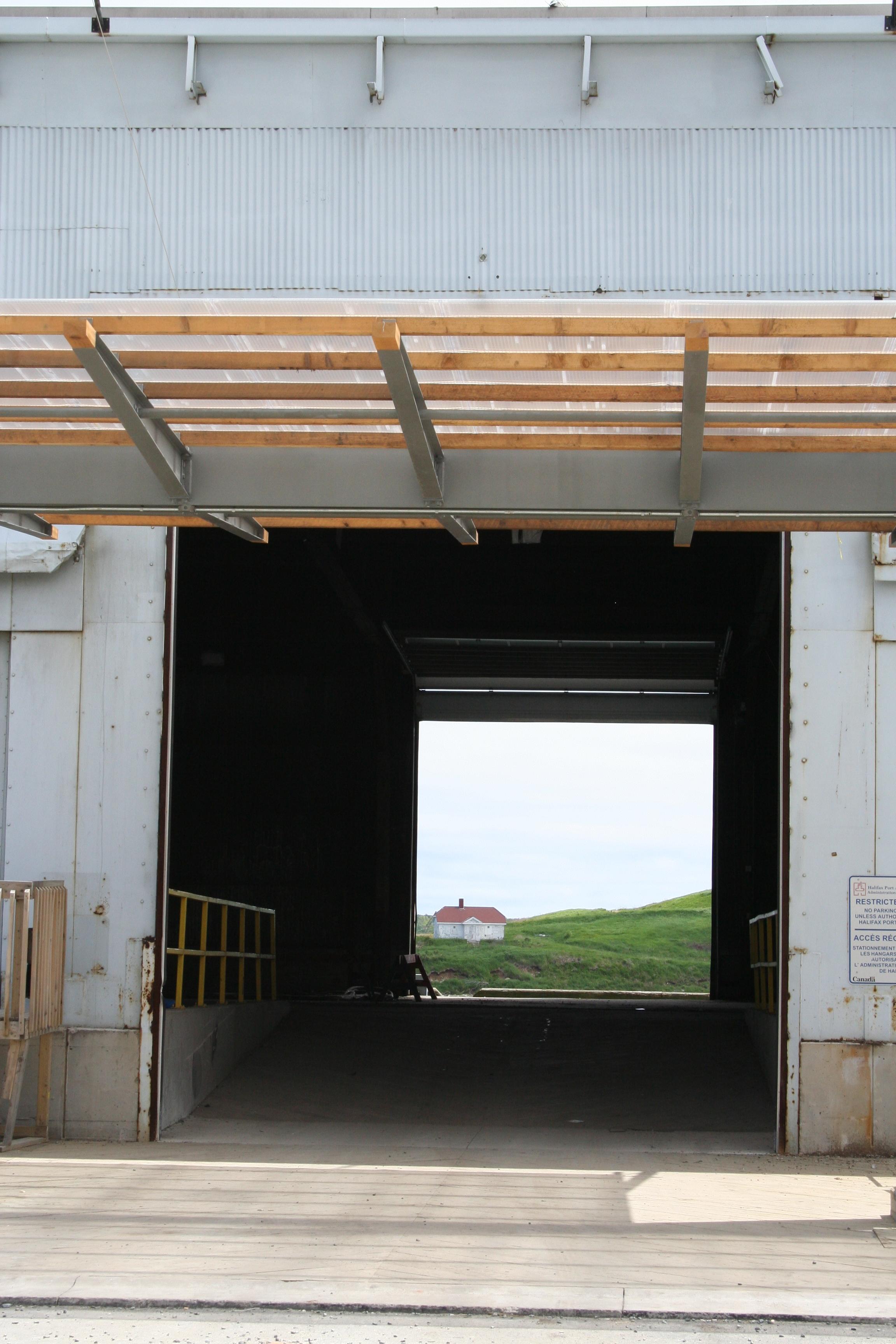 View of Georges Island in Halifax Harbour through abandoned hangar, Nova Scotia (Canada) (© Christophe Rivet