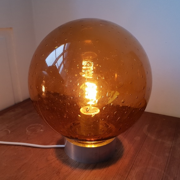 Lamp made from a orange glass sphere