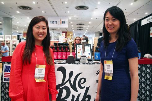 Janet and Anne Chung, sisters, and co-founders of We Rub You All Natural Korean BBQ Sauces. Picture Taken at the Specialty Food Association Fancy Food Show in 2013, where We Rub You won a sofi Award for Outstanding Cooking Sauce or Flavor Enhancer.