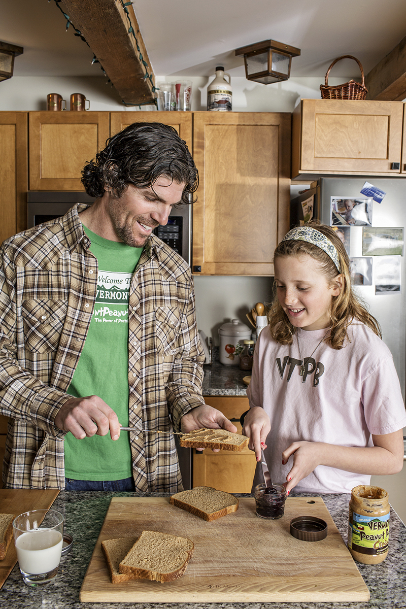Chris Kaiser, Founder and CEO of Vermont Peanut Butter, making peanut butter sandwiches with his daughter.