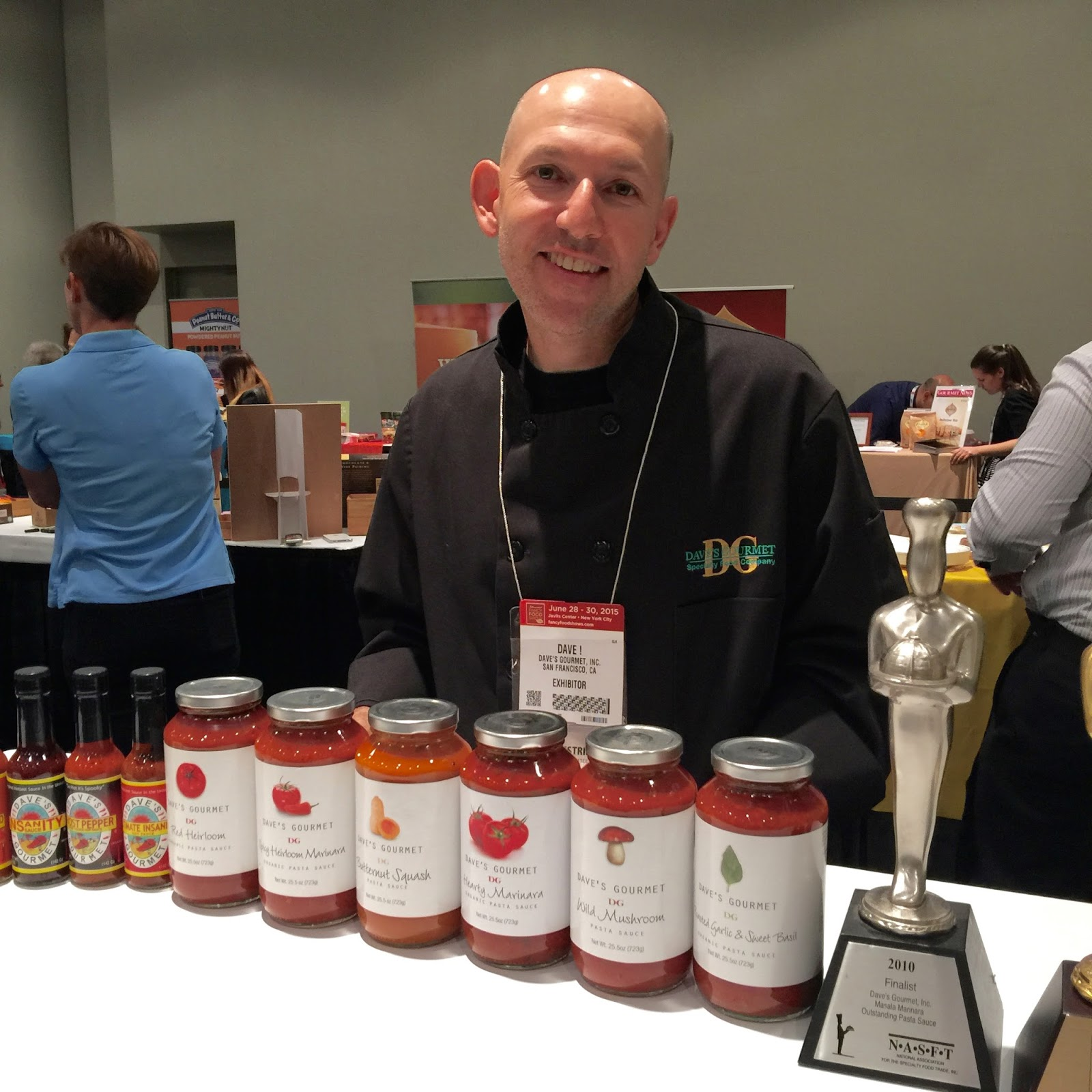Dave Hirschkop, Founder and CEO of Dave's Gourmet, displaying his sauces at the Specialty Foods Show.