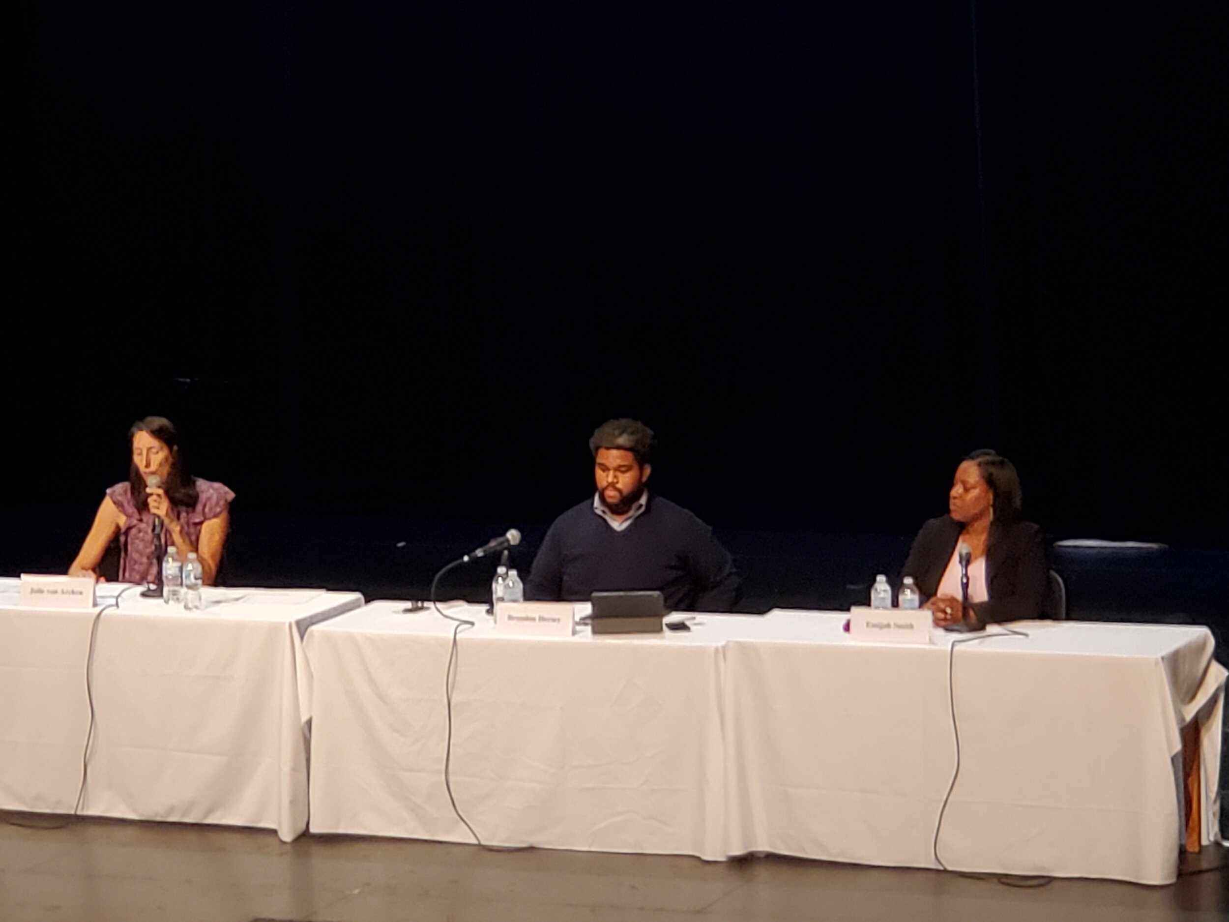 (From left to right: Julie Van Arcken, Brandon Hersey and Emijah Smith ponder questions during the final District VII candidate forum at Rainier Beach High School.)