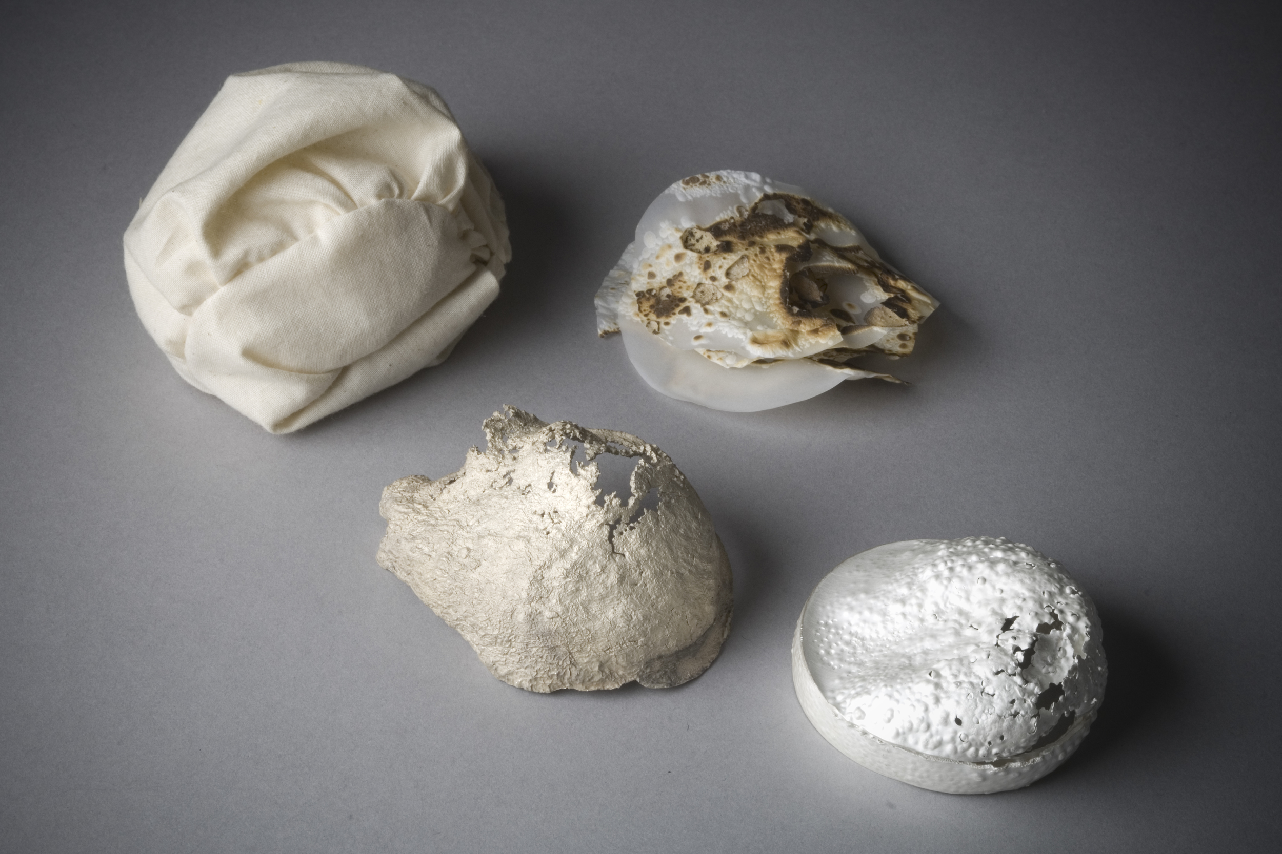 inconsolable  | Detail 7 | Cotton, Rice, Thread, Vellum, and Silver | 2009